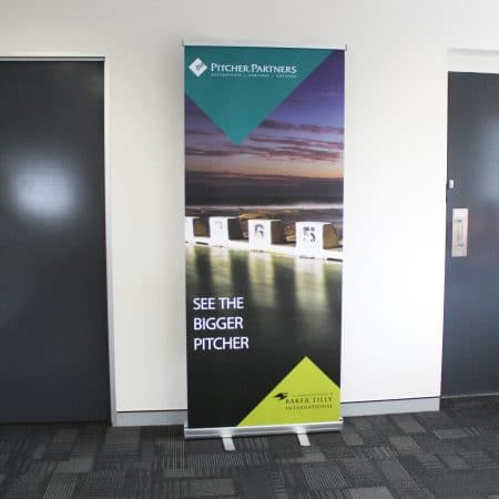 pitcher patners pull up standee printing by jennings print group