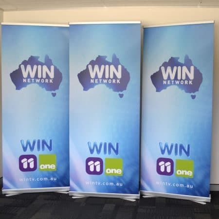 win tv pull up standee printing by jennings print group