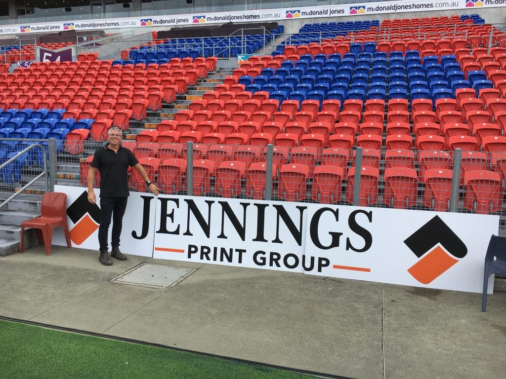 bleachers with jennings print group signage